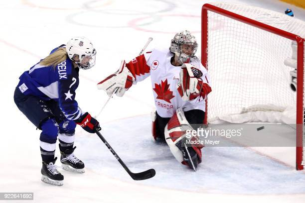 Monique Lamoureux-Morando of the United States scores a goal against Shannon Szabados of Canada in the third period during the Women's Gold Medal...