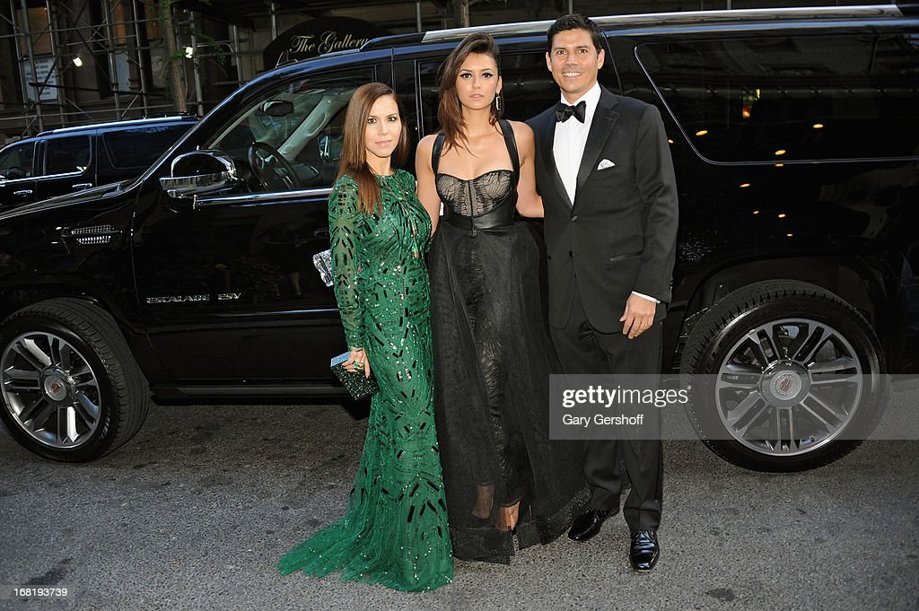 Monique Lhuiller, Nina Dobrev and Tom Bugbee head to Met Gala in a Cadillac Escalade on May 6, 2013 in New York City.
