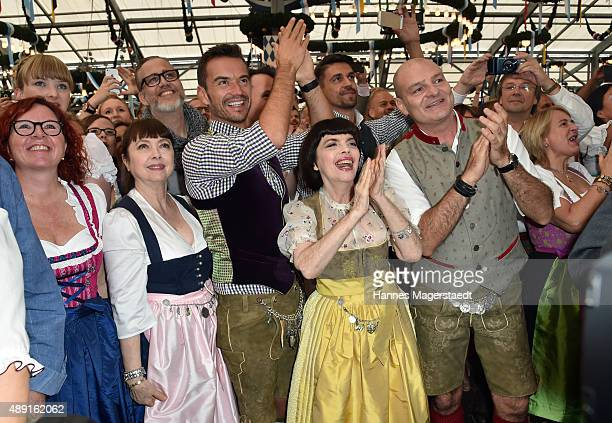 Monique Mathieu Florian Silbereisen and Mireille Mathieu pose at Schottenhamel beer tent during the Oktoberfest 2015 Opening at Theresienwiese on...