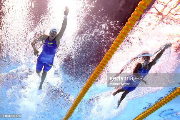 Monique Olivier of Luxembourg and Natthanan Chankrajang of Thailand compete in the Women's 400m Freestyle heats on day one of the Gwangju 2019 FINA...