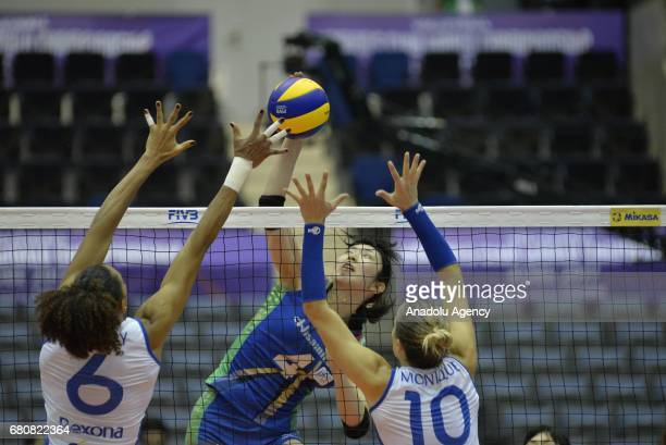 Monique Pavao and Juciely Barreto of RexonaSesc in action against Nana Iwasaka of Hisamitsu Spring during the pool match of the FIVB Womens Club...