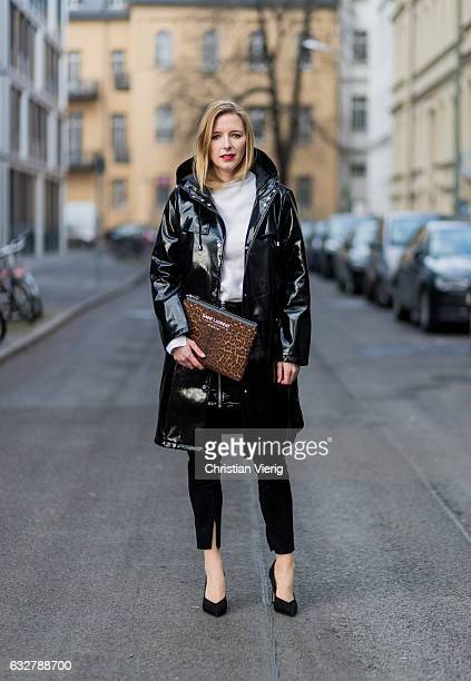 Monique Romanowski wearing wearing a white knit Macro Polo, a black PVC jacket and sleather skirt Mango, a Saint Laurent clutch and copped denim...