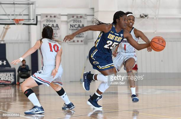 Monique Smith of the Kent State Golden Flashes dribbles between two Robert Morris Colonials defenders in the second half during the game at North...