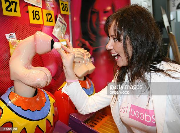 Monique tries out a novelty sideshow style game at the Sydney Sexpo 27 July 2006 This year marks the tenth anniversary of the Sydney Sexpo an adult...