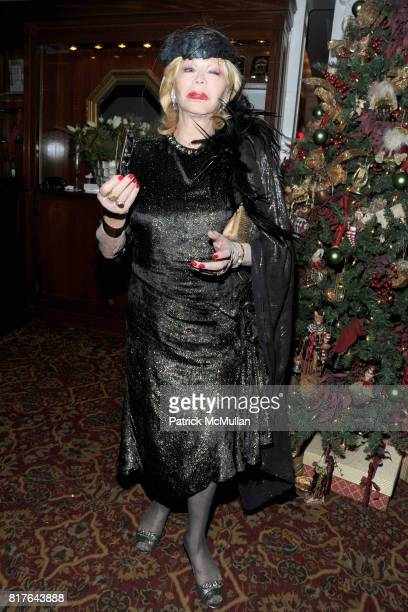 Monique van Vooren attends ANNE HEARST MCINERNEY JAY MCINERNEY and GEORGE FARIAS Holiday Party at 21 Club on December 16 2010 in New York City