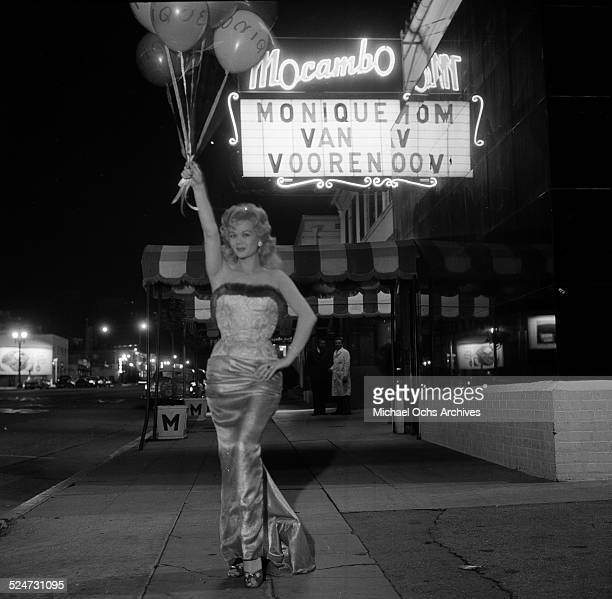 Monique van Vooren poses with balloons before performing at Mocambo's night club in Los AngelesCA