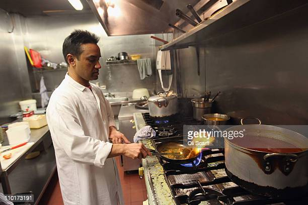 Monir Uddin the head chef at Cafe Bangla curry house on Brick Lane prepares a lamb curry on March 16 2011 in London England From April 2011 the...