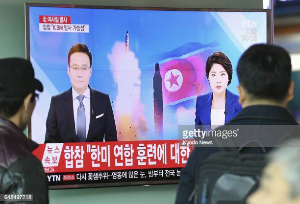 A monitor at a station in Seoul reports news about North Korea's launch of four ballistic missiles on March 6 2017 The missiles flew as far as 1000...