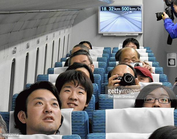 A monitor behind maglev train passengers shows they are moving at 500 kph during a test ride on November 13 2014 in Tsuru Yamanashi Japan One hundred...