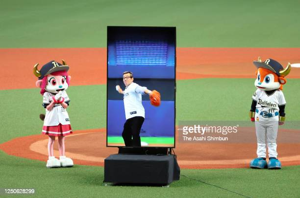 Monitor displaying Osaka City Mayor Ichiro Matsui throwing during the virtual ceremonial first pitch prior to the game between Tohoku Rakuten Golden...
