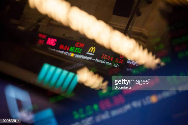 A monitor displaying stock market information is reflected on the floor of the New York Stock Exchange in New York US on Monday Jan 8 2018 US stocks...