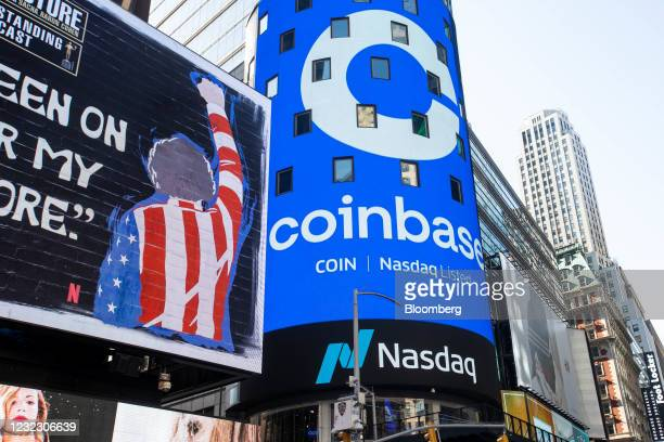 Monitor displays Coinbase signage during the company's initial public offering at the Nasdaq MarketSite in New York, U.S., on Wednesday, April 14,...
