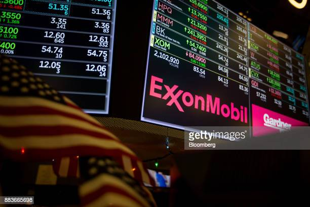 A monitor displays Exxon Mobil Corp signage on the floor of the New York Stock Exchange in New York US on Friday Dec 1 2017 US stocks fell and gold...