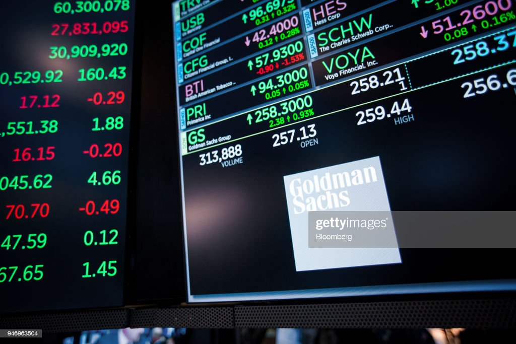 A monitor displays Goldman Sachs Group Inc. signage on the floor of the New York Stock Exchange (NYSE) in New York, U.S., on Monday, April 16, 2018. U.S. stocks rallied and Treasuries slid as geopolitical tensions eased and investors turned their attention to corporate results. Photographer: Michael Nagle/Bloomberg via Getty Images