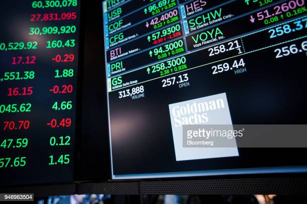 A monitor displays Goldman Sachs Group Inc signage on the floor of the New York Stock Exchange in New York US on Monday April 16 2018 US stocks...
