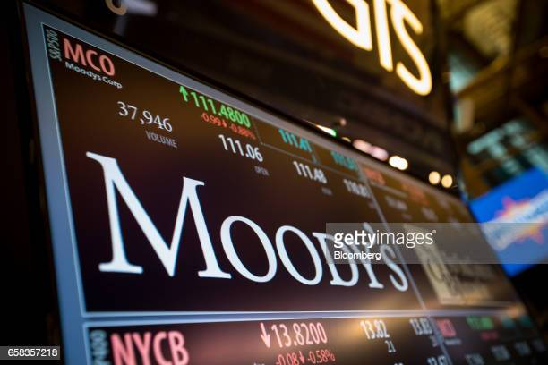 A monitor displays Moody's Corp signage on the floor of the New York Stock Exchange in New York US on Monday March 27 2017 US stocks fell extending a...
