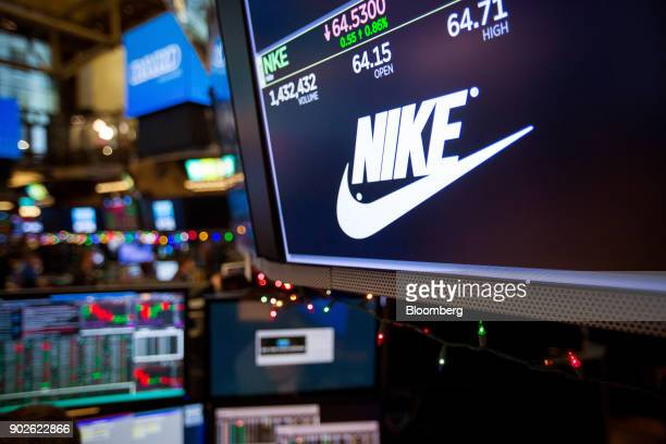 A monitor displays Nike Inc signage on the floor of the New York Stock Exchange in New York US on Monday Jan 8 2018 US stocks were mixed with the SP...