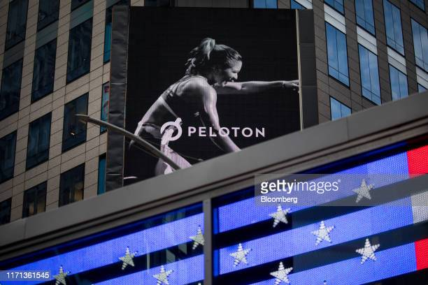 Monitor displays Peloton Interactive Inc. Signage during the company's initial public offering across from the Nasdaq MarketSite in New York, U.S.,...