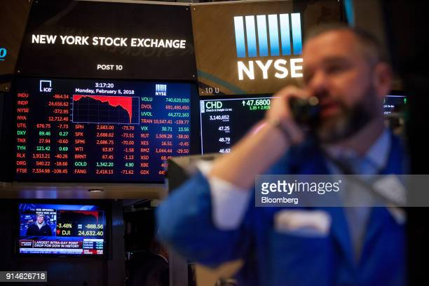 A monitor displays stock information as a trader works on the floor of the New York Stock Exchange in New York US on Monday Feb 5 2018 US stocks...