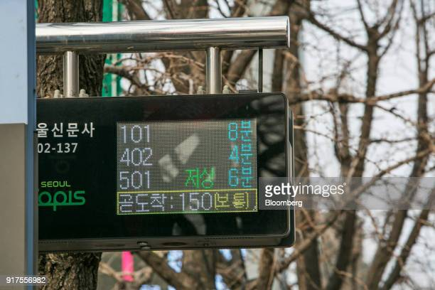 A monitor displays the estimated arrival times of buses at a bus stop in Seoul South Korea on Sunday Jan 28 2018 5G the fifthgeneration wireless...