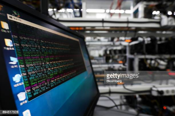 A monitor displays the status of cryptocurrency mining at a mining facility in Incheon South Korea on Friday Dec 15 2017 Hedge funds are pulling out...