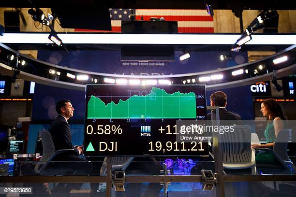 A monitor displays Tuesday's final numbers for the Dow Jones Industrial Average on the floor of the New York Stock Exchange December 13 2016 in New...