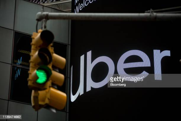 A monitor displays Uber Technologies Inc signage in front of Morgan Stanley headquarters in the Times Square area of New York US on Friday April 26...