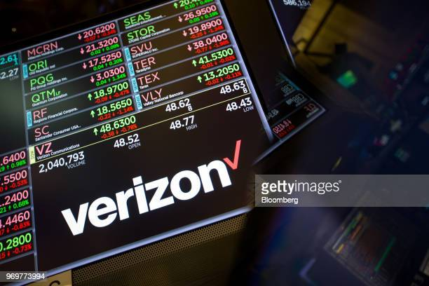 Monitor displays Verizon Communications Inc. Signage on the floor of the New York Stock Exchange in New York, U.S., on Friday, June 8, 2018. Most...