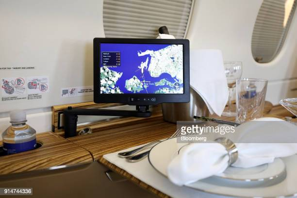 A monitor is displayed inside an Embraer SA Legacy 500 jet during the Singapore Airshow held at the Changi Exhibition Centre in Singapore on Tuesday...