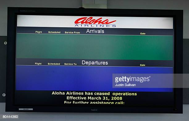 A monitor is void of scheduled arrival and departure information at an empty Aloha Airlines ticket counter at Oakland International Airport March 31...