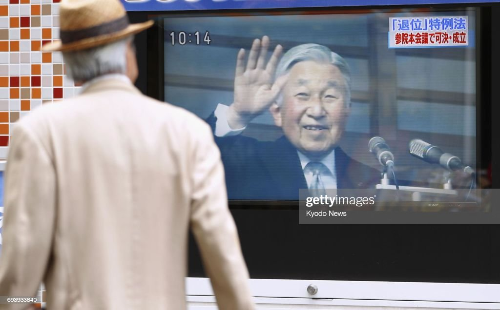 A monitor on a street in Tokyo announces the enactment of a law on June 9, 2017, to allow 83-year-old Emperor Akihito to pass the throne to his elder son Crown Prince Naruhito in what would be Japan's first abdication in two centuries. ==Kyodo