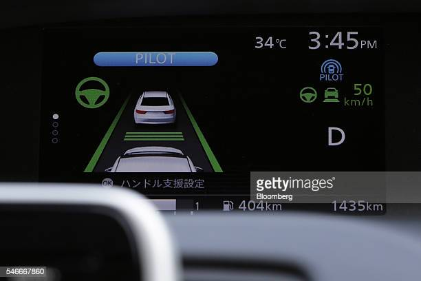 A monitor on the instrument panel of a Nissan Motor Co Serena minivan displays the system information of the automaker's ProPilot autonomousdrive...