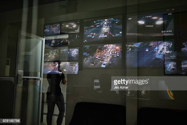 Monitor screens are reflection on a glass wall inside the Public Safety and Security command center on May 8 2016 in Davao City Mindanao Philippines...
