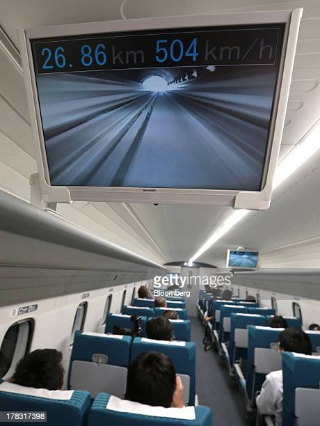 A monitor showing a live view from the front of the train and the current speed is seen inside the L0 series magneticlevitation train developed by...