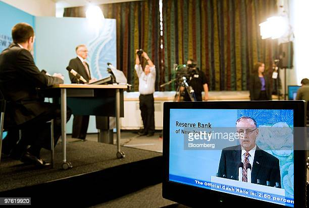 A monitor shows Alan Bollard governor of the Reserve Bank of New Zealand speaking during a news conference at the central bank in Wellington New...