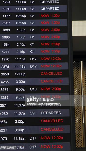 A monitor shows how many flights were canceled or delayed at RDU Airport in Morrisville NC Tuesday Jan 7 as a result of the havoc played on the...