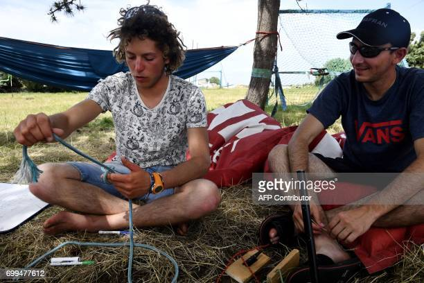 A monitor teaches how to knot a rope during a trainee of Les Glenans sailing school on June 13 2017 in Les Glenans Fouesnant western France Seventy...