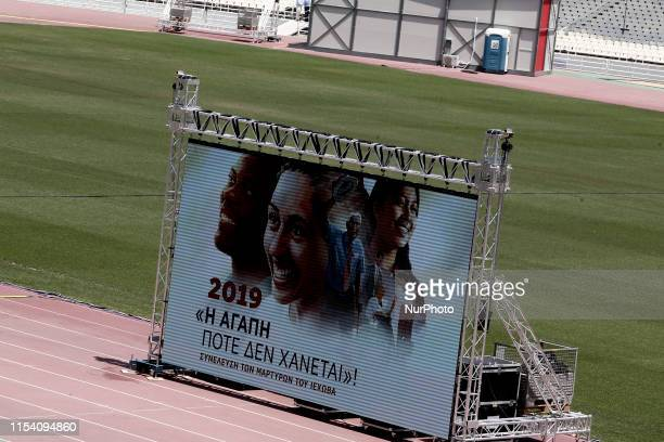 Monitor with the slogan LOVE NEVER FAILS at the Jehovahs Witnesses Convention at the Olympic stadium in Athens Greece on July 5 2019