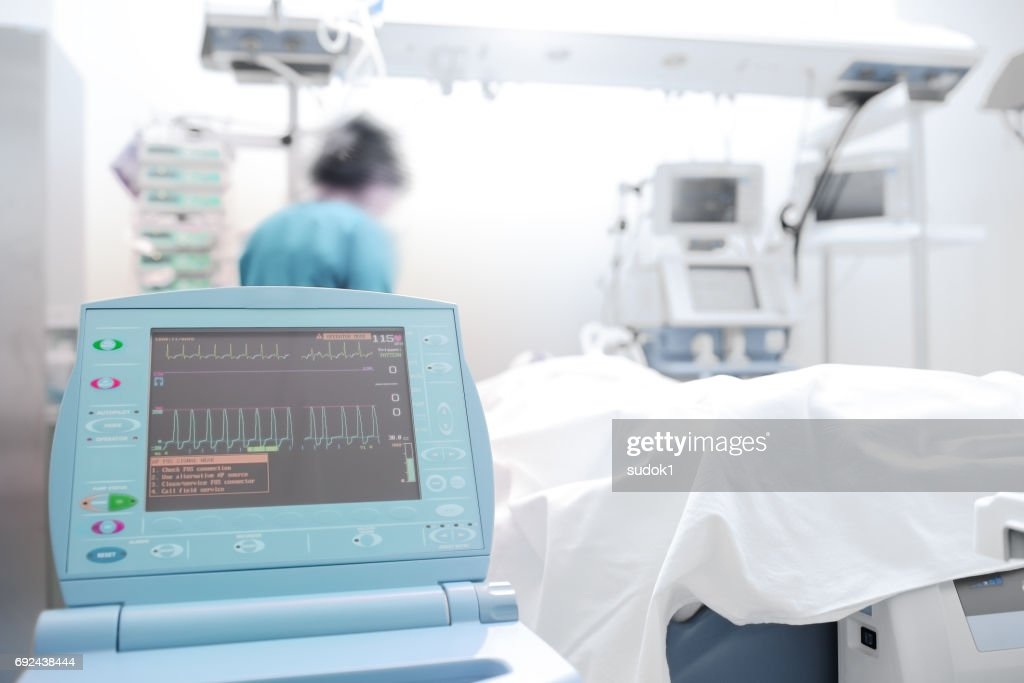 Monitoring of heart activity of patient : Stock Photo