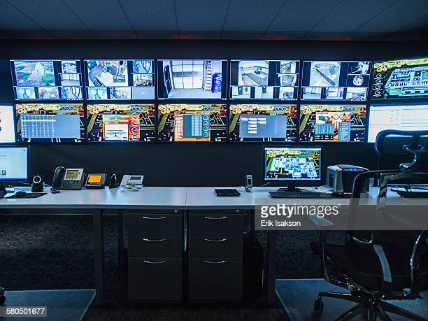 Monitors and empty desk in control room