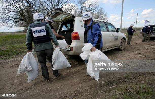 OSCE monitors are inspecting the site near village Pryshyb near Lugansk on April 25 where OSCE patrol vehicle was destroyed by an explosion on April...