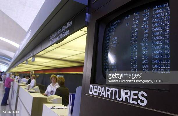 Monitors at LambertSt Louis International Airport indicate all flights have been cancelled by the FAA who have applied security measures