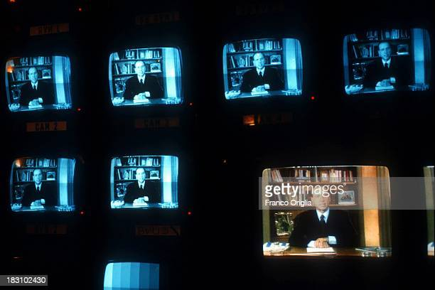 Monitors at RAI television studios display Silvio Berlusconi broadcasting a video message that announces his debut in politics on January 26 1994 in...