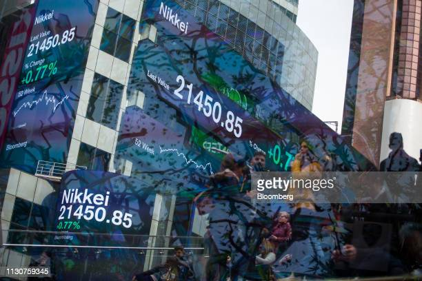Monitors display Nikkei figures outside Morgan Stanley Co headquarters in the Times Square neighborhood of New York US on Friday March 15 2019 US...