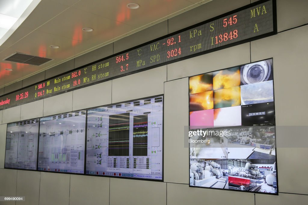Monitors display operations information in a control room at the Sahiwal coal power plant owned by China`s stateowned Huaneng Shandong Rui Group in...