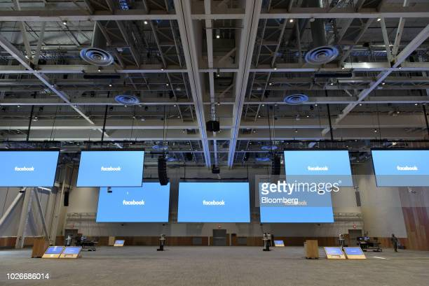 Monitors display signage at the 2,000-person convention center style space at the new Facebook Inc. Frank Gehry-designed MPK 21 office building in...