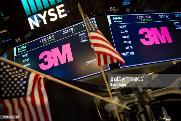 Monitors display signage for 3M Co on the floor of the New York Stock Exchange in New York US on Monday Oct 23 2017 US stocks got off to a slow...