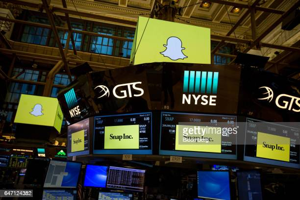 Monitors display Snap Inc signage on the floor of the New York Stock Exchange during the company's initial public offering in New York US on Thursday...