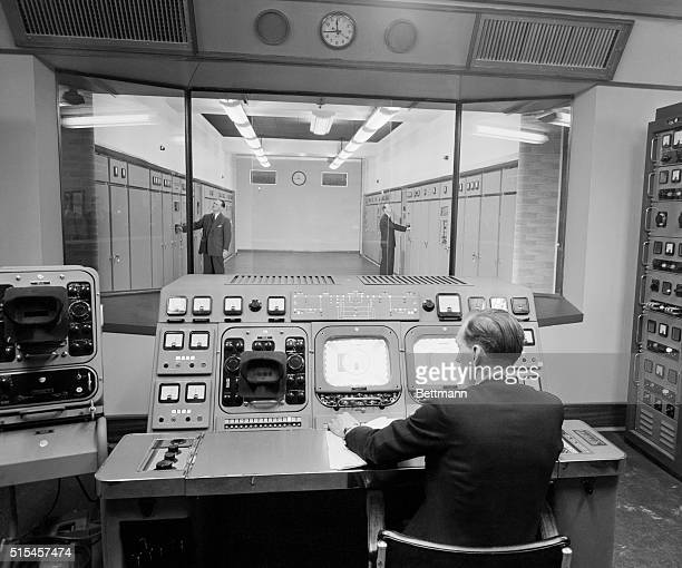 Monitors for incoming and outgoing signals are observed by a technician at the new TV transmitting station for the BBC at London's Crystal Palace The...