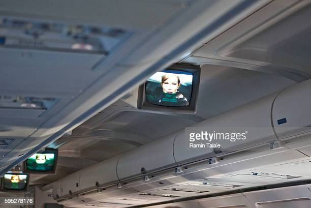 TV monitors play a video showing safety features onboard of a Delta Airlines Boeing 757200 plane at HartsfieldJackson Atlanta International Airport...